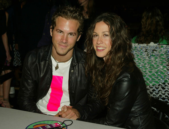 Ryan Reynolds and Alanis Morrisette holding hands before their split