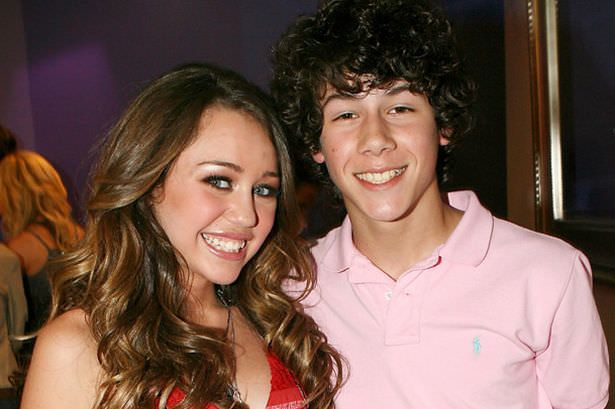 A young Miley Cyrus and Nick Jonas back when they were dating in 2006