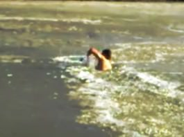 man rescues dog from frozen water