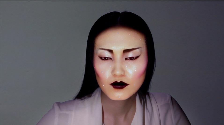 Project face mask, bold make-up, purple lipstick